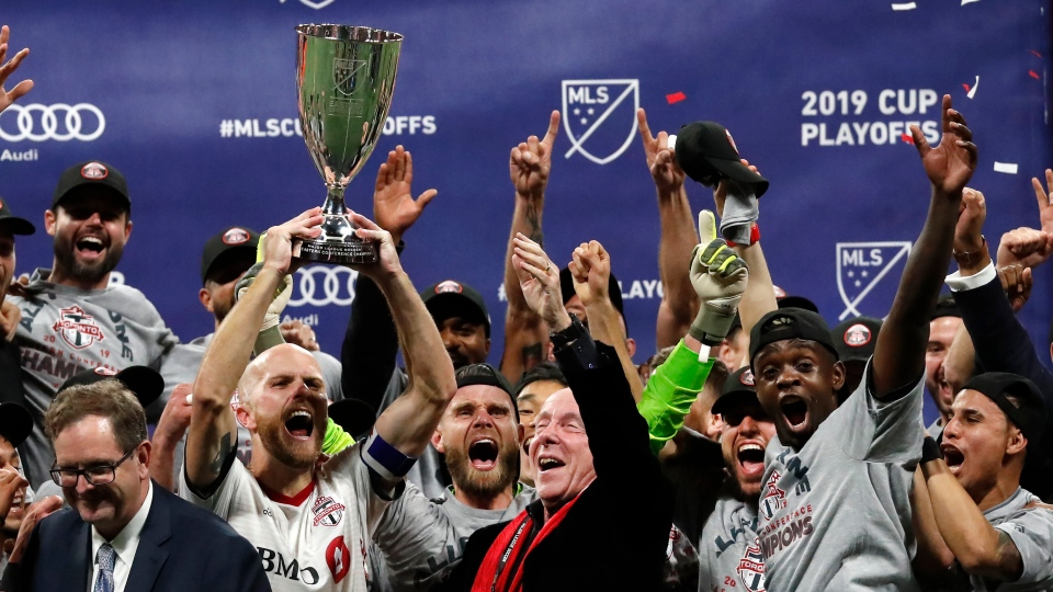 Toronto FC players react during the trophy presentation after defeating Atlanta United 2-1 in their MLS Eastern Conference final soccer match Wednesday, Oct. 30, 2019 in Atlanta. (AP Photo/John Bazemore)