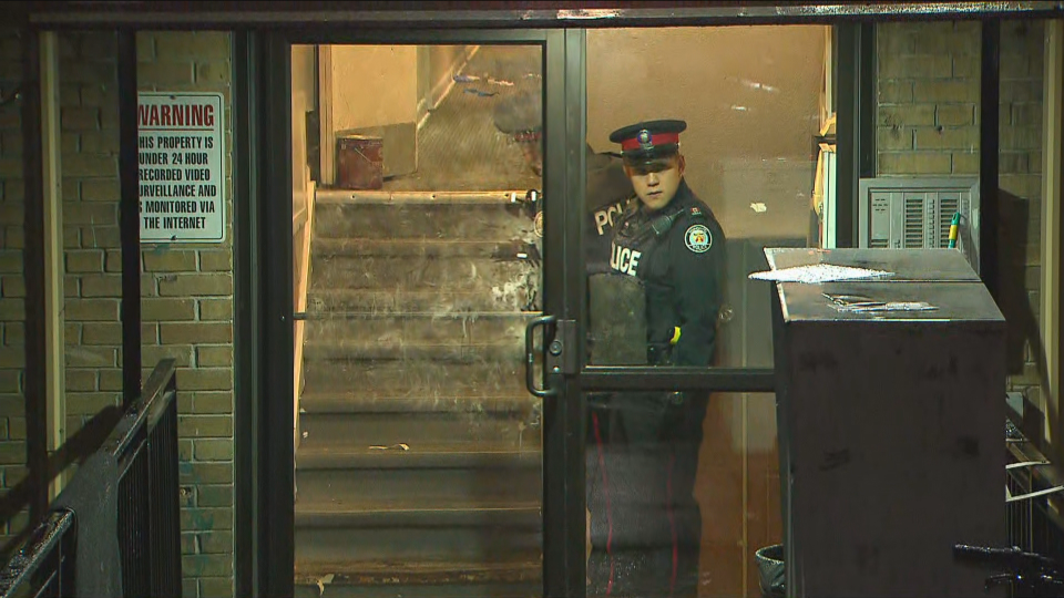 Police are seen at a building on Clearview Heights on Thursday after a shooting left five teens injured.