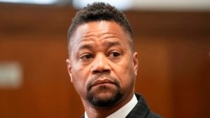 FILE - This Oct. 10, 2019 file photo shows Cuba Gooding Jr. in a courtroom in New York. Gooding Jr. faces new charges in his sexual misconduct case. The actor's lawyer says he's due in a New York City court on Thursday, Oct. 31, for arraignment on an updated misdemeanor indictment. (Steven Hirsch/New York Post via AP, Pool)