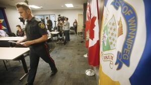 Winnipeg Police Service Constable Jay Murray addresses media in the Osborne area in Winnipeg, Monday, April 23, 2018. THE CANADIAN PRESS/John Woods