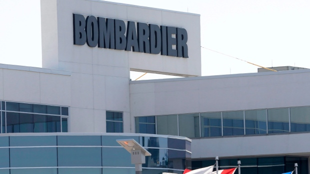 Flags fly outside a Bombardier plant in Montreal on May 14, 2015. Bombardier Inc. has signed a deal to sell its aerostructures business to Spirit AeroSystems Holding Inc. (THE CANADIAN PRESS/Ryan Remiorz)