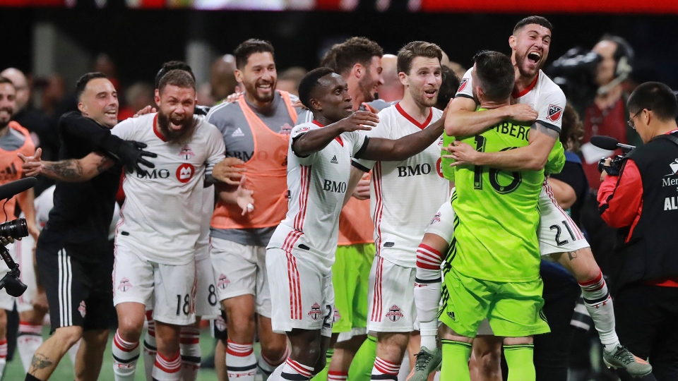Toronto FC celebrates defeating Atlanta United 2-1 in the MLS soccer Eastern Conference final Wednesday, Oct. 30, 2019, in Atlanta. (Curtis Compton/Atlanta Journal-Constitution via AP)