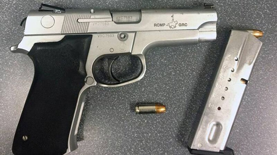 An RCMP issued handgun and magazine is shown in a handout image from Toronto police.