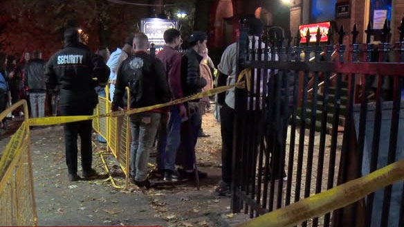 Police investigate following a stabbing at a Halloween party on Madison Avenue in The Annex.