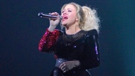 FILE - In this Feb. 22, 2019 file photo, Kelly Clarkson performs onstage during the Meaning of Life tour at the Allstate Arena in Rosemont, Ill. Clarkson is becoming the latest entertainer to announce a residency in Las Vegas. (Photo by Rob Grabowski/Invision/AP, File)