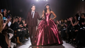 FILE - In this Feb. 16, 2015, file photo, designer Zac Posen and model Naomi Campbell greet the crowd after his Fall 2015 collection is modeled during Fashion Week, in New York. Posen is shutting down his namesake label. (AP Photo/John Minchillo, File)