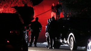 Contra Costa County Sheriff deputies investigate a multiple shooting in Orinda, Calif., on Thursday, Oct. 31, 2019. Four people were killed and four others wounded in a Halloween night party shooting at a large rental home in a wealthy San Francisco Bay Area community, police said Friday. (Ray Chavez/East Bay Times via AP)