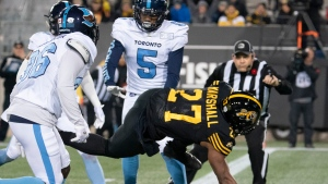 Hamilton Tiger Cats running back Cameron Marshall (27) gets across the goal line for a touchdown during first-half CFL football game action against the Toronto Argonauts, in Hamilton, Ont., Saturday, Nov. 2, 2019. THE CANADIAN PRESS/Peter Power