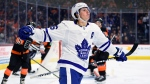 Toronto Maple Leafs' Mitchell Marner celebrates after scoring goal against Philadelphia Flyers goaltender Brian Elliott during the third period of an NHL hockey game Saturday, Nov. 2, 2019, in Philadelphia. The Maple Leafs won 4-3 in a shootout. (AP Photo/Derik Hamilton)