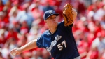 Milwaukee Brewers starting pitcher Chase Anderson throws in the first inning of a baseball game against the Cincinnati Reds, Thursday, Sept. 26, 2019, in Cincinnati. (AP Photo/John Minchillo)