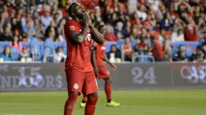 Toronto FC forward Jozy Altidore (17) reacts after missing the net during second half MLS Soccer action against the Montreal Impact, in Toronto, on Saturday, Aug. 24, 2019. Toronto FC striker Jozy Altidore offered a blunt update Monday on the quad strain that has kept him out of the MLS playoffs. THE CANADIAN PRESS/Andrew Lahodynskyj