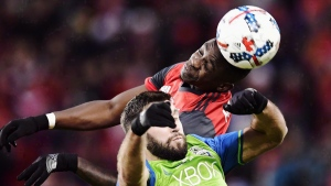 Toronto FC defender Chris Mavinga, top, heads the ball above Seattle Sounders defender Will Bruin during first half MLS Cup Final soccer action in Toronto on Saturday, December 9, 2017. Toronto FC will have an early start Sunday at the MLS Cup final in Seattle, with kickoff at noon local time (3 p.m. ET). THE CANADIAN PRESS/ Frank Gunn