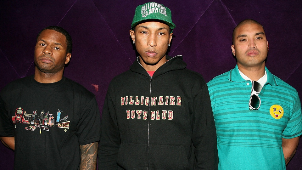 "In this photo released by Starpix, the members of N.E.R.D. are seen on set where they are shooting a music video for their single ""Everybody Knows."" From left N.E.R.D. is Shay Haley, Pharrell Williams and Chad Hugo. Williams and Hugo also make up the producing team clled ""The Neptunes."" (AP Photo/Starpix, Dave Allocca)"