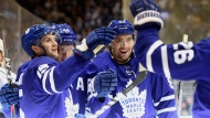 Toronto Maple Leafs centre Alexander Kerfoot (15) celebrates his goal against Los Angeles Kings goaltender Jonathan Quick (32) during second period NHL action in Toronto on Tuesday, Nov. 5, 2019. THE CANADIAN PRESS/Frank Gunn