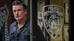 FILE - This Friday, Nov. 2, 2018, file photo shows actor Alec Baldwin leaving New York Police Department's 10th Precinct, after his arrest for allegedly punching a man in the face over a parking spot. Baldwin filed a defamation lawsuit Friday, Nov. 1, 2019, against the man who says Baldwin hit him in the face during an argument over the parking space. (AP Photo/Julie Jacobson, File)