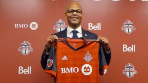 Toronto FC new general manager Ali Curtis holds up a club jersey at a news conference introducing Curtis in Toronto, Thursday, Jan.3, 2019. THE CANADIAN PRESS/Neil Davidson