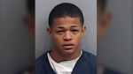 Osiris Williams is shown in a booking photo provided by the Fulton County, Ga., Sheriff's Office. (Fulton County, Ga., Sheriff's Office via AP)