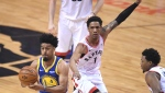 Golden State Warriors guard Quinn Cook (4) moves past Toronto Raptors guard Patrick McCaw (1)during first half basketball action in Game 1 of the NBA Finals in Toronto on Thursday, May 30, 2019. (FILE/THE CANADIAN PRESS/Frank Gunn)