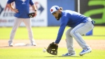 Toronto Blue Jays infielder Devon Travis takes part in a drill during baseball spring training in Dunedin, Fla., on February 16, 2019. Former Toronto Blue Jays second baseman Devon Travis has declined his assignment to triple-A Buffalo and elected to become a free agent. Injuries have troubled Travis for years. He has been out of the big leagues since 2018 when he played a career-high 103 games. THE CANADIAN PRESS/Nathan Denette