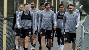 Seattle Sounders players, including Brad Smith (11) Gustav Svensson (4) and Alex Roldan (16) arrive for a training session, Wednesday, Nov. 6, 2019, in Tukwila, Wash. The Sounders will face Toronto FC Sunday in the MLS Cup soccer match at CenturyLink Field in Seattle, the third time the two teams have met for the MLS championship. (AP Photo/Ted S. Warren)