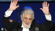 FILE - In this Aug. 28, 2019, file photo, Opera star Placido Domingo performs during a concert in Szeged, Hungary. The Tokyo Olympics organizing committee says opera legend Domingo has said he won't perform at pre-Olympics cultural events in Japan. (AP Photo/Laszlo Balogh, File)