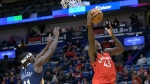 Toronto Raptors forward Pascal Siakam (43) shoots against New Orleans Pelicans guard Jrue Holiday (11) during the first half of an NBA basketball game in New Orleans, Friday, Nov. 8, 2019. (AP Photo/Matthew Hinton)