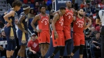 Toronto Raptors forward Serge Ibaka (9) suffered a sprained ankle during the first half against the New Orleans Pelicans on Friday. (Matthew Hinton/The Associated Press)