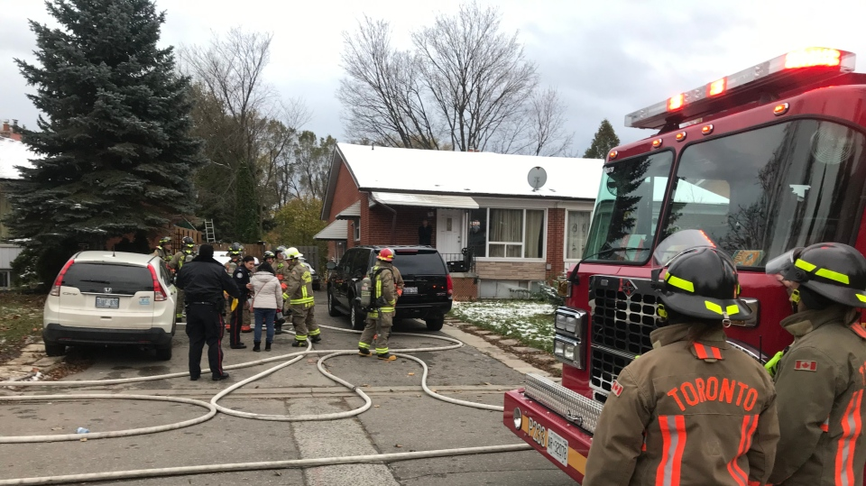A woman and child have been transported to hospital with life-threatening injuries after being rescued from a North York house fire this afternoon. (CP24/ Francis Gibs)