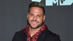 "FILE - This Aug. 26, 2019 file photo shows ""Jersey Shore"" cast member Ronnie Ortiz-Magro at the MTV Video Music Awards in Newark, N.J. Ortiz-Magro pleaded not guilty to domestic violence, child endangerment, false imprisonment and other misdemeanors Friday, Nov. 8, after his arrest last month in the Hollywood Hills. (Photo by Evan Agostini/Invision/AP, File)"