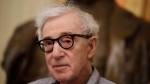 "FILE - In this Tuesday, July 2, 2019 file photo, director Woody Allen attends a press conference at La Scala opera house, in Milan, Italy. The filmmaker had sued Amazon in February after the online giant ended his contract without ever releasing a completed film, ""A Rainy Day in New York."" Amazon had responded that Allen, whose daughter Dylan has accused him of molesting her, breached the deal by making insensitive remarks about the #MeToo movement. In papers filed Friday, Nov. 8, 2019, in U.S. District Court, Allen and Amazon agreed that the case should be dismissed without prejudice. (AP Photo/Luca Bruno)"
