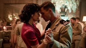 "This image released by Lionsgate shows Mandy Moore, left, and Ed Skrein in a scene from ""Midway."" (Reiner Bajo/Lionsgate via AP)"