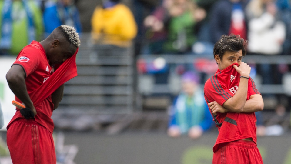 Toronto FC defender Chris Mavinga (23) and Toronto FC forward Tsubasa Endoh (31) react to losing to the Seattle Sounders following the MLS Cup soccer final in Seattle on Sunday, November 10, 2019. THE CANADIAN PRESS/Jonathan Hayward