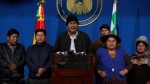 Bolivia's President Evo Morales, center, speaks during a press conference at the military base in El Alto, Bolivia, Sunday, Nov. 10, 2019. (AP Photo/Juan Karita)