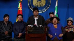 Bolivia's President Evo Morales, center, speaks during a press conference at the military base in El Alto, Bolivia, Sunday, Nov. 10, 2019. (AP Photo/Juan Karita)