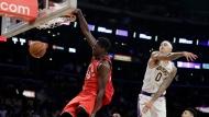 Toronto Raptors' Pascal Siakam, left, dunks past Los Angeles Lakers' Kyle Kuzma (0) during the second half of an NBA basketball game Sunday, Nov. 10, 2019, in Los Angeles. (AP Photo/Marcio Jose Sanchez)