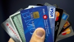 Credit cards are displayed in Montreal, Wednesday, December 12, 2012. Zombie debt will inevitably come back to haunt Canadians because of the country's scourge of consumer indebtedness, say insolvency experts. THE CANADIAN PRESS/Ryan Remiorz