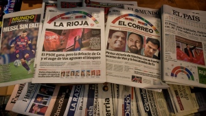 Spanish newspapers announce the victory of Spain's Prime Minister and candidate of the Spanish Socialist Party, Pedro Sanchez, a day after the general election, in Pamplona, northern Spain, Monday, Nov. 11, 2019. Spain looked set Monday to face political uncertainty for many more months after the country's fourth elections in as many years further complicated an already messy political situation. (AP Photo/Alvaro Barrientos)
