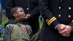 A young boy attends Remembrance Day ceremonies at the Grand Parade in Halifax on Monday, Nov. 11, 2019. THE CANADIAN PRESS/Andrew Vaughan