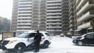 Police are seen outside an apartment building after an air conditioner fell on a child on Nov. 11, 2019. (Corey Baird/CTV News Toronto)