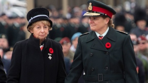 Governor General Julie Payette holds the hand of Silver Cross Mother Reine Samson Dawe after she placed a wreath during the Remembrance day ceremony at the National War Memorial Monday November 11, 2019 in Ottawa. THE CANADIAN PRESS/Adrian Wyld