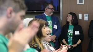 "Toby and Bernadine Boulet look at one another as they are recognized during an event for Green Shirt Day and National Organ and Tissue Donation Awareness Week in Ottawa on April 3, 2019. The father of a young hockey player who donated his organs after dying in a catastrophic bus crash says a new bill before the Alberta legislature addressing the issue is a good start but has a long way to go. ""(It's) a great start,"" said Toby Boulet. ""In Alberta we need to do better."" Six people benefitted from organs harvested from the body of Boulet's son Logan, a member of the SJHL's Humboldt Broncos who was among 16 killed when the team's bus collided with a truck in 2018. THE CANADIAN PRESS/Sean Kilpatrick"