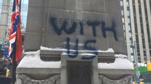 """Ye broke faith with us"" was spray-painted on the cenotaph at Old City Hall one day after Remembrance Day. (Carol Charles/ CTV News Toronto)"