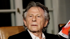 "FILE - In this Oct. 30, 2015, file photo, filmmaker Roman Polanski tells reporters he can ""breath with relief"" after a Polish judge ruled that the law forbids his extradition to the U.S., in Krakow, Poland. The Paris screening of a new French-Italian film ""An Officer and a Spy"" is going ahead despite a new allegation that its director Roman Polanski raped a woman decades ago. The screening on Tuesday, Nov. 12, 2019 will be attended by the film's crew (AP Photo/Jarek Praszkiewicz, File)"