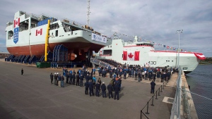 Shipbuilders, military personnel, politicians and interested parties attend the naming ceremony for Canada's lead Arctic and Offshore Patrol Ship, the future HMCS Harry DeWolf, at Halifax Shipyard in Halifax on Friday, Oct. 5, 2018. THE CANADIAN PRESS/Andrew Vaughan