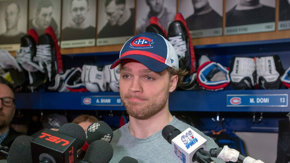 In this April 9, 2019 file photo, Montreal Canadiens center Max Domi speaks to the media at the team's end of the NHL hockey season availability in Brossard, Quebec.  As a hockey player with Type 1 diabetes,   Domi was inspired by the chance encounter with Hockey Hall of Famer Bobby Clarke. Now he's trying to do the same for the next generation of kids trying to make the NHL despite the complications of the disease.  (Ryan Remiorz/The Canadian Press via AP, File)