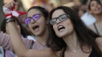 Student protesters chant slogans against the Lebanese government, in Beirut, Lebanon, Tuesday, Nov. 12, 2019. Protesters in Lebanon resumed demonstrations on Tuesday blocking some roads and governmental institutions. (AP Photo/Hassan Ammar)