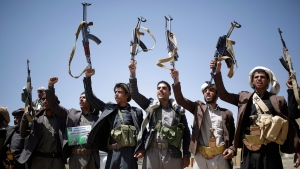 In this Sept. 21, 2019 file photo, Shiite Houthi tribesmen hold their weapons as they chant slogans during a tribal gathering showing support for the Houthi movement, in Sanaa, Yemen. Saudi Arabia and Yemen's Iran-backed Houthi  rebels are holding indirect, behind-the-scenes talks to end the impoverished Arab country's devastating five-year war. Officials from both sides have told The Associated Press, Wednesday, Nov. 13, 2019, that the negotiations are taking place with Oman, which borders both Yemen and Saudi Arabia, as mediator. (AP Photo/Hani Mohammed, File)