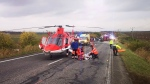 Emergency services helicopter at the scene after a bus collided with a truck Wednesday Nov. 13, 2019, near the town of Nitranske Hrnciarovce, Slovakia, Wednesday Nov. 13, 2019. Officials say at least 13 people have died in the accident with about 20 injured, some seriously. (HaZZ-Presidium of Fire and Rescue Corps via AP)