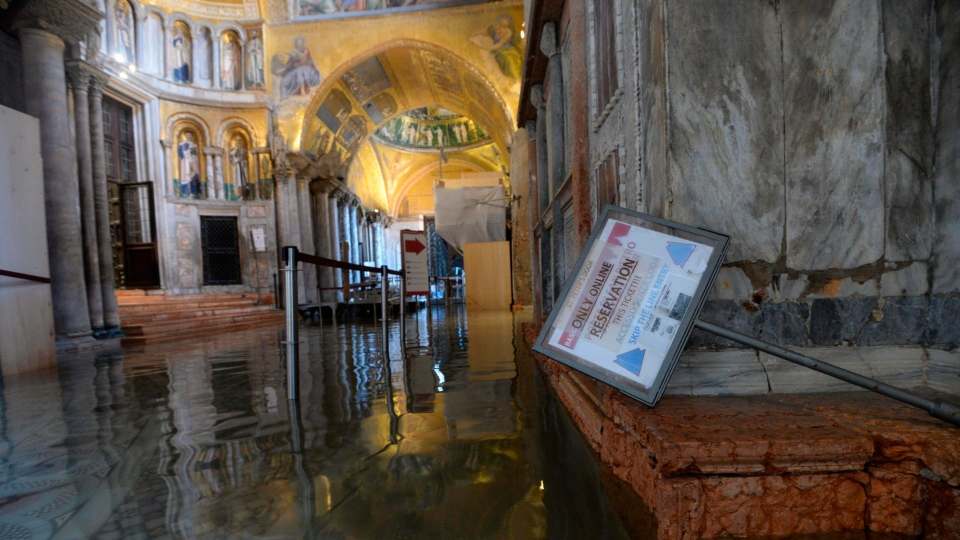 High water floods the inside of St. Mark's Basilica, in Venice, Wednesday, Nov. 13, 2019. The high-water mark hit 187 centimeters (74 inches) late Tuesday, Nov. 12, 2019, meaning more than 85% of the city was flooded. The highest level ever recorded was 194 centimeters (76 inches) during infamous flooding in 1966. (AP Photo/Luca Bruno)