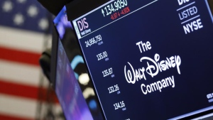 The logo for The Walt Disney Company appears above a trading post on the floor of the New York Stock Exchange. The company's streaming service Disney Plus says it hit more than 10 million sign-ups on its first day of launch, far exceeding expectations. RICHARD DREW / ASSOCIATED PRESS